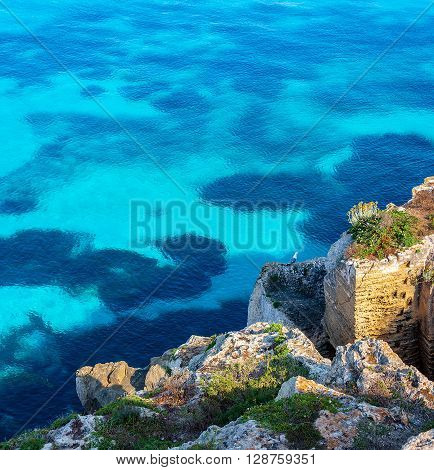 A cliff over the blu mediterranean sea