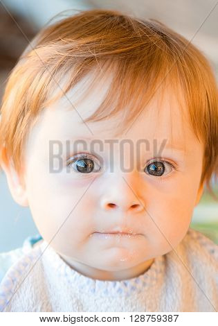 The expressive look of a child staring at you