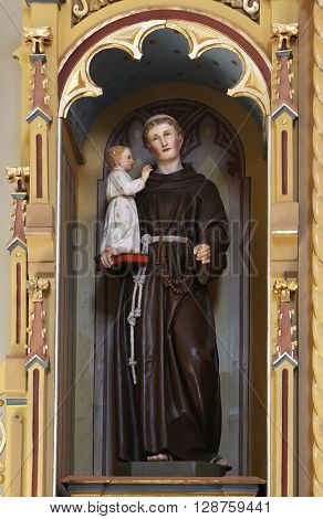 STITAR, CROATIA - AUGUST 27: St. Anhony of Padua holding baby Jesus, altar of St. Anthony the Great in the church of Saint Matthew in Stitar, Croatia on August 27, 2015
