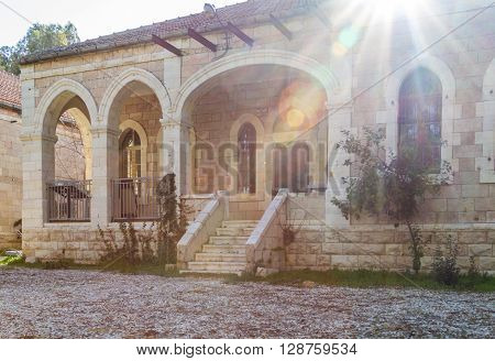 JERUSALEM ISRAEL - FEBRUARY 27: Mediterranean urban landscape - Stone house with archs and arched windows faced with white stone in the sunlight in Jerusalem Israel on February 27 2016