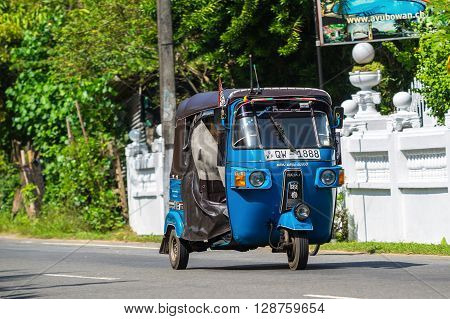 Bentota, Sri Lanka - December 31, 2015: Tuk-tuk Moto Taxi On The Street. Famous Thai Moto-taxi Calle