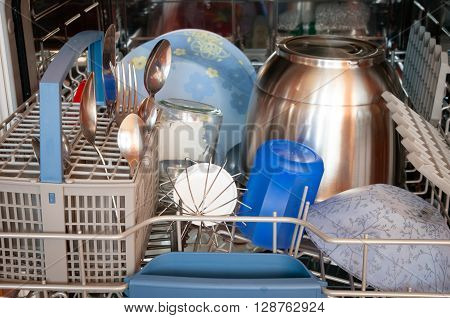 Dishwasher after cleaning process dining utensils and appliances