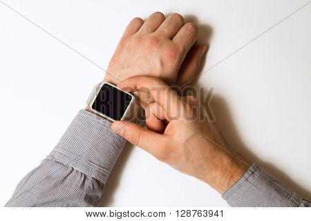 smart watch on a male hand on white background. Mock up. Top view