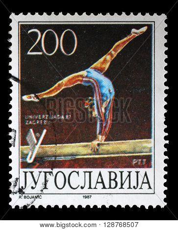 ZAGREB, CROATIA - JUNE 14: A stamp printed by Yugoslavia shows Gymnastics, Universiade in Zagreb, circa 1987, on June 14, 2014, Zagreb, Croatia
