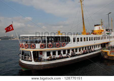ISTANBUL/TURKEY-OCTOBER 14, 2014: Sehir Hatlari ferry at pier. October 14, 2014-Istanbul/Turkey.