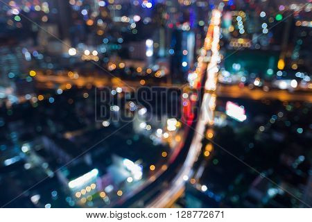 Abstract blurred bokeh lights, aerial view city road intersection night view