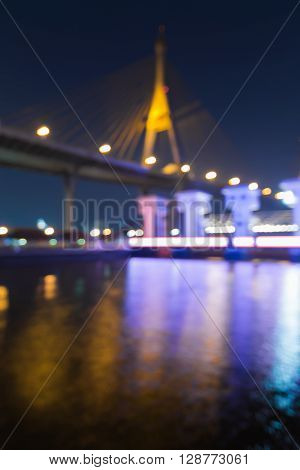 Abstract blurred bokeh lights suspension bridge and watergate night view