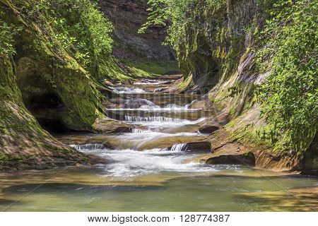 Water cascades down The Potholes at Fall Creek Gorge Preserve in Warren County Indiana.