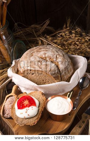 a fresh and tasty homemade bread with cream and tomato