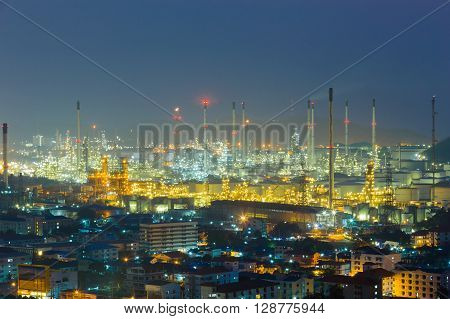 Twilight oil refinery lights night view, Industrial plant