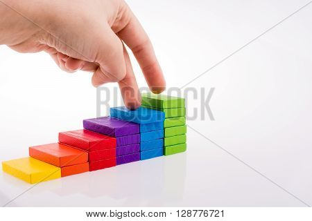 Hand Playing With Colored Domino