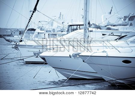 White yachts is moored in harbour