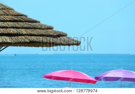 Parasols Made With Bamboo And Straw In The Luxurious Resort By The Sea