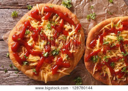 Homemade Hungarian Langos With Cheese And Ketchup Close-up. Horizontal Top View