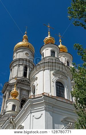 The bell tower of the Assumption Cathedral (1844) in sunny day in Kharkiv Ukraine