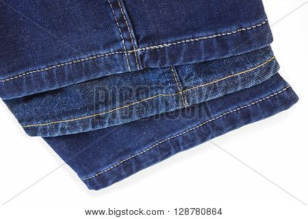 Bright thread seams on blue denim trousers on a white background