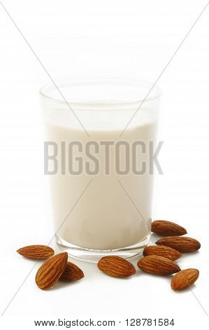 almond and milk in glass with almonds