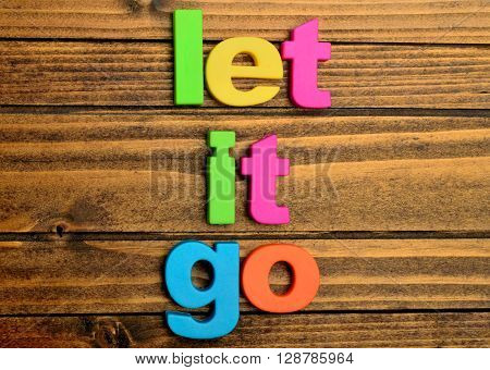Words Let it go on wooden table