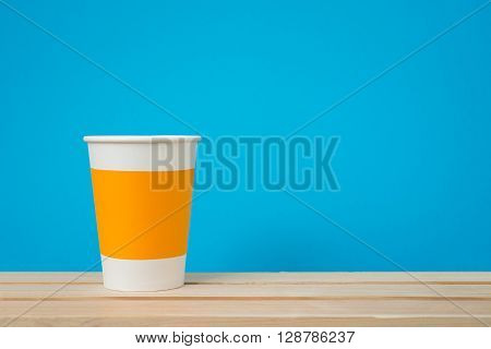 Paper cup with Sleeve on blue background