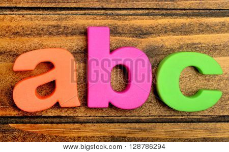Colorful letters word ABC on wooden table