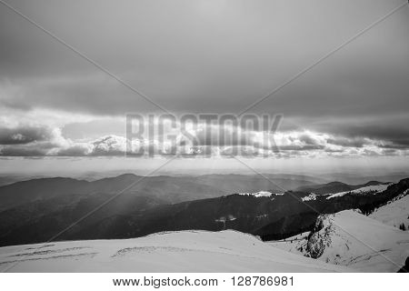 Black And White Winter Landscape Over Carpathian Mountains. Panorama Of Snow Mountain Range Landscap