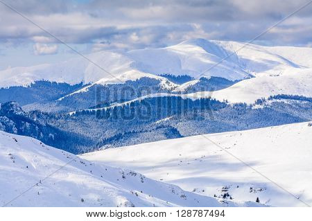 Winter Landscape Over Carpathian Mountains. Panorama Of Snow Mountain Range Landscape With Blue Sky