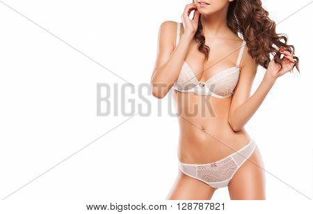 Beautiful sporty woman body. Sexy body of a beautiful woman. Slim tanned woman's body. Beautiful sexy female slim tanned body