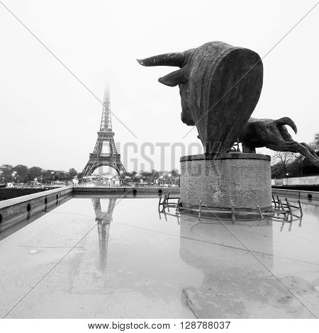 Sculptures and fountains on Trocadero and Eiffel Tower in Paris, France. Black and white vintage image. Square composition.