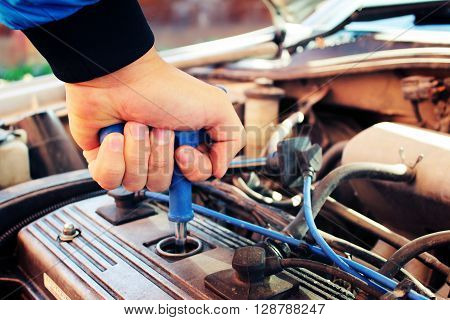 Hand with wrench - for spark plugs