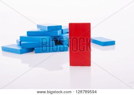 Color Dominoes scattered on a white background