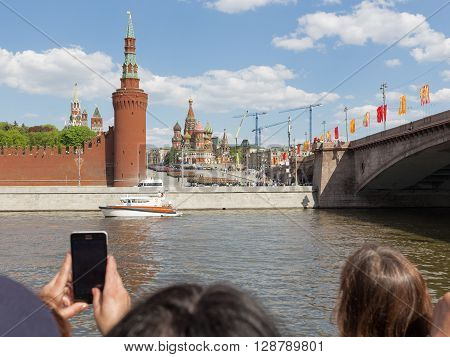 Moscow - May 6 2016: The military are marching during the final rehearsal of the Victory Parade on Red Square and people take pictures on the phone May 6 2016 Moscow Russia