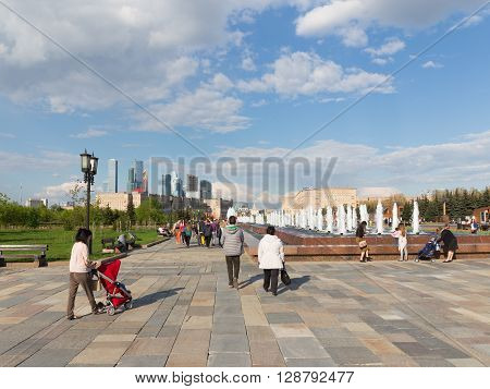 Moscow - May 6 2016: A lot of people walk in the beautiful city of Victory Park on Kutuzovsky Prospekt on Poklonnaya Hill May 6 2016 Moscow Russia