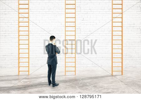 Brick interior with thoughtful businessman next to career ladders. 3D Rendering