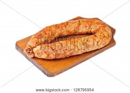 sausage on cutting board isolated on white background