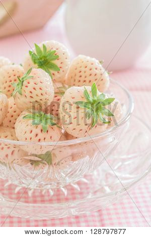 Pineberries or Hula Berries a hybrid strawberry with a pineapple flavor white flesh and red seeds