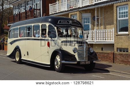 Felixstowe, Suffolk, England - May 01, 2016:  Vintage cream and black Bedford bus being driven along street.