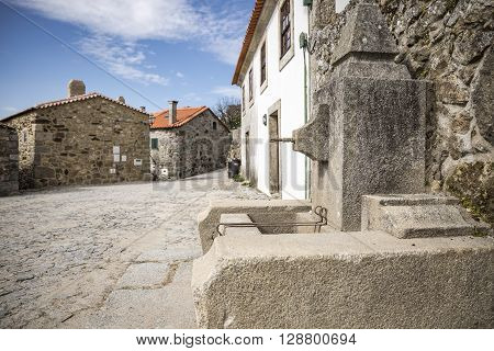 a street and a water fountain in Linhares da Beira Historical Village, Guarda, Portugal