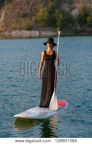 Silhouette Of A Beautiful Woman On Stand Up Paddle Board. Sup06