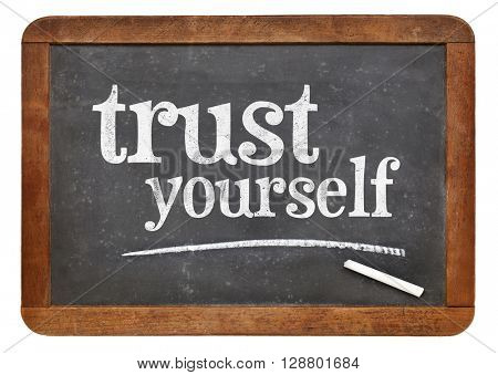 Trust yourself  - white chalk text on a vintage slate blackboard