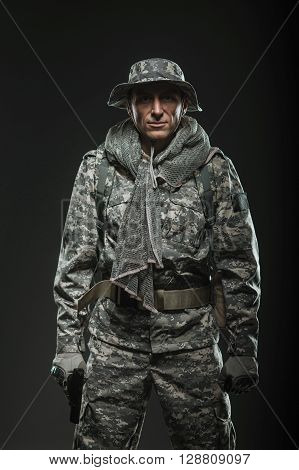 Military war conflict soldiers - Special forces soldier man with gun on a dark background. Military equipment NATO soldiers