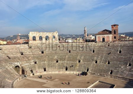 VERONA, ITALY - DECEMBER 15: Panoramic view of the famous Verona Arena an ancient roman amphitheater still in use with city skyline DECEMBER 15, 2015 in Verona, Italy