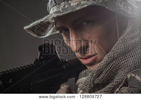 Military war conflict soldiers - Special forces soldier man hold Machine gun on a dark background. Military equipment soldiers