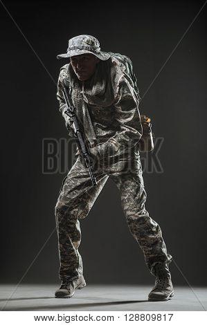 Special Forces Soldier Man With Machine Gun On A  Dark Background