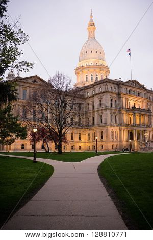 The lights come up on the capital building in Lansing.