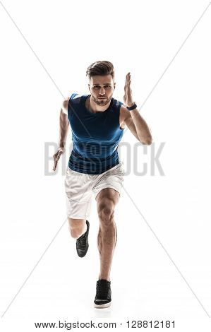 Portrait of cheerful young runner jogging with strength. Man is looking forward with desire. Isolated on background