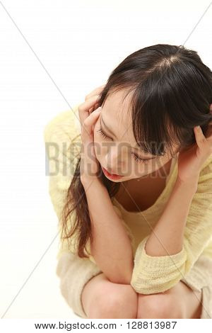 portrait of depressed woman on white background