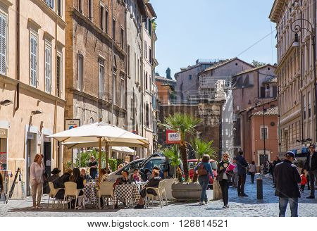 ROME, ITALY - APRIL 8, 2016:  Restaurant and people waiting to be served at the Rome's street