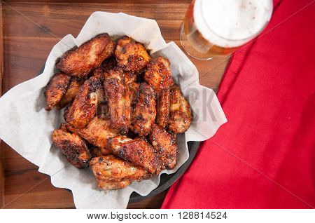 hot and spicy buffalo style chicken wings in a basket
