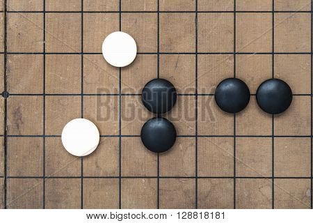 Go game board traditional chinese game. Weiqi game board. Stones on a Go board