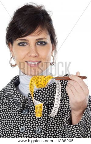 Attractive Girl With  Tape Measure In The Hand